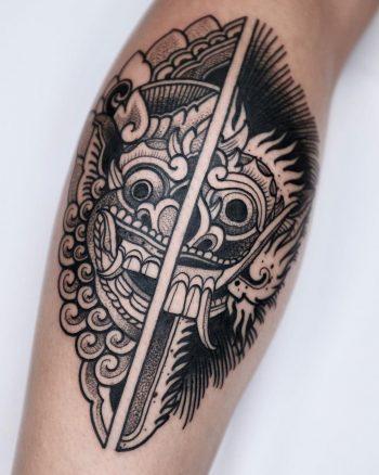 Barong vs Rangda tattoo by @romain_labordille