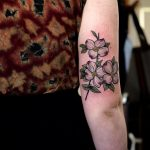 Dogwood flowers tattoo by @sophiabaughan