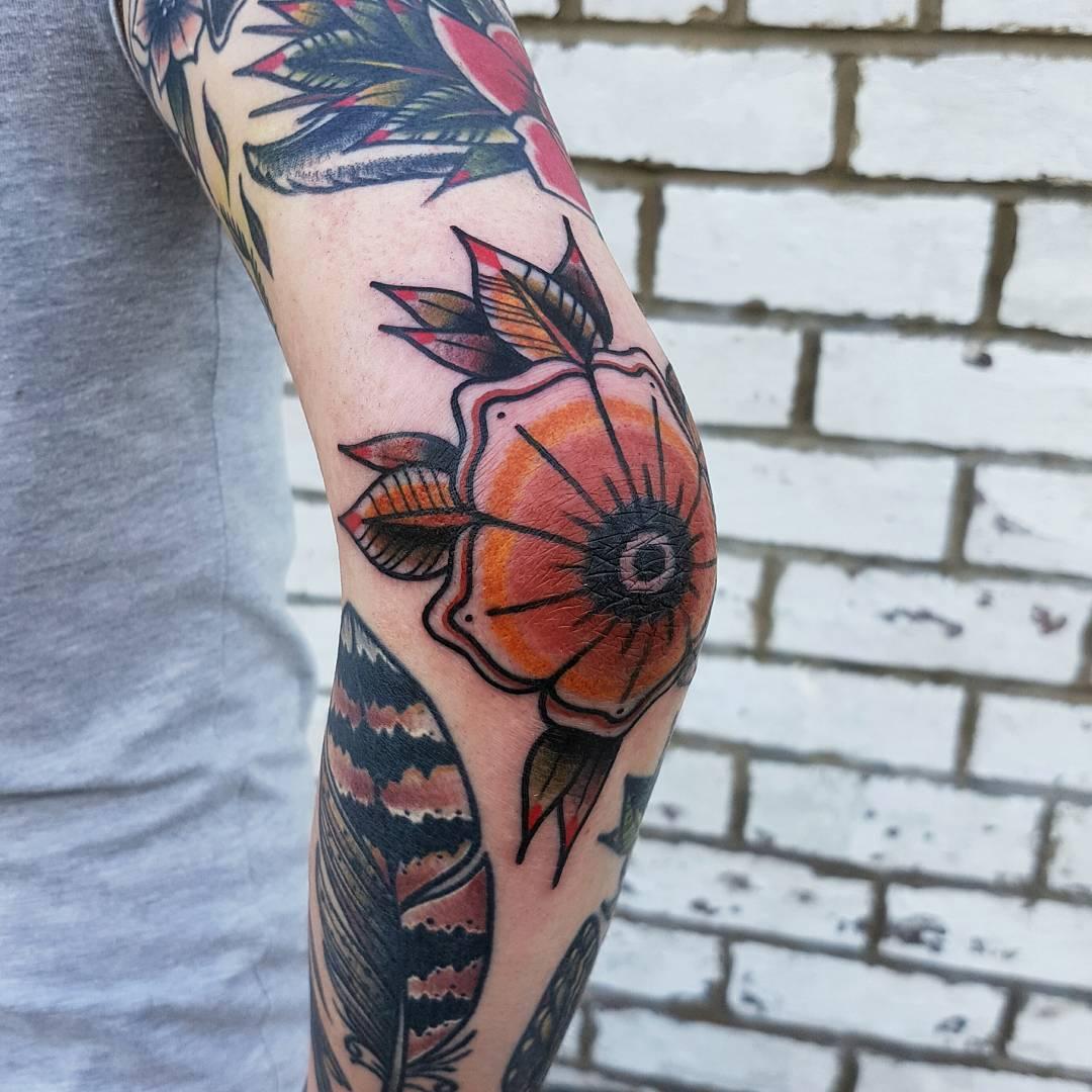 Elbow flower by @rabtattoo