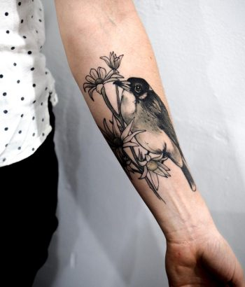 Flannel flowers and Butcherbird tattoo by @sophiabaughan