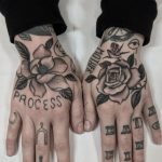 Flowers on both hands by @justinoliviertattoo