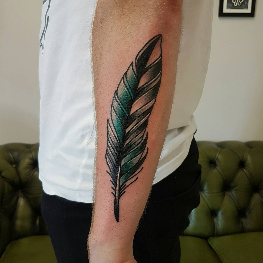 Forearm feather by @rabtattoo