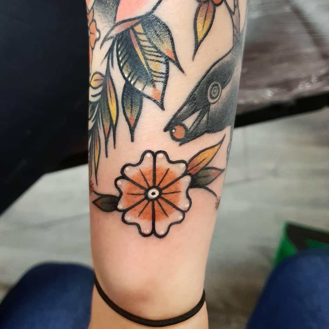 Little pinwheel tattoo by @rabtattoo