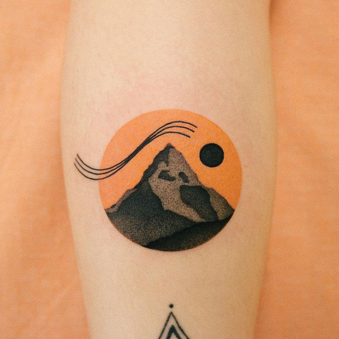 Mountain and orange sky by @takemymuse