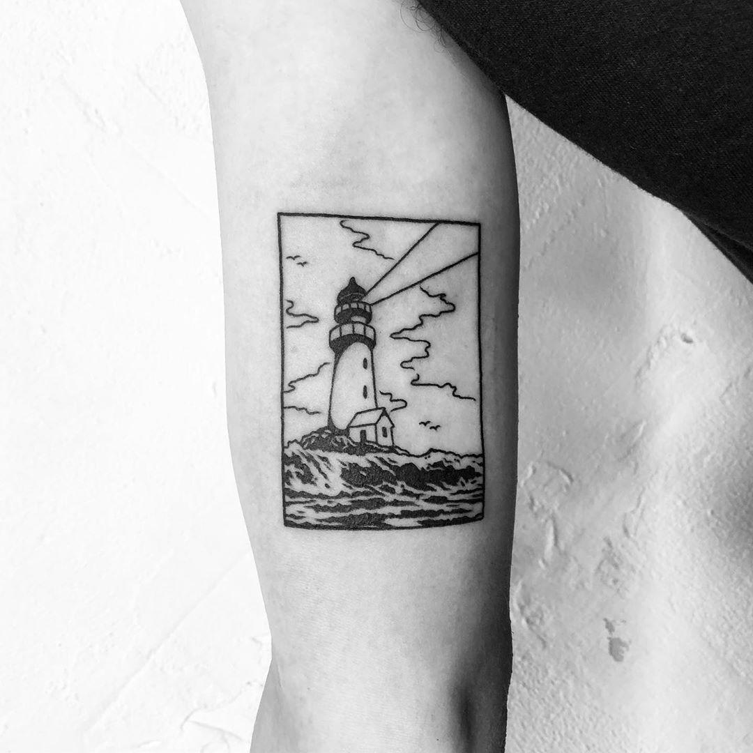 A lighthouse by @alexbergertattoo