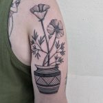 Poppies in a pot by @justinoliviertattoo