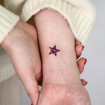 Red star cover-up by @tattooist_sigak
