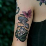 Shrooms and butterfly by @lindseebeetattoo