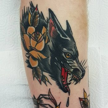 Trad wolf by @rabtattoo