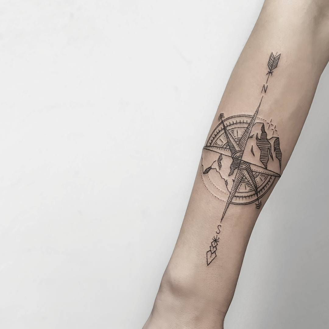 Compass and mountains by @isaarttattoo