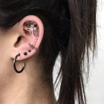 Ear piece by @isaarttattoo