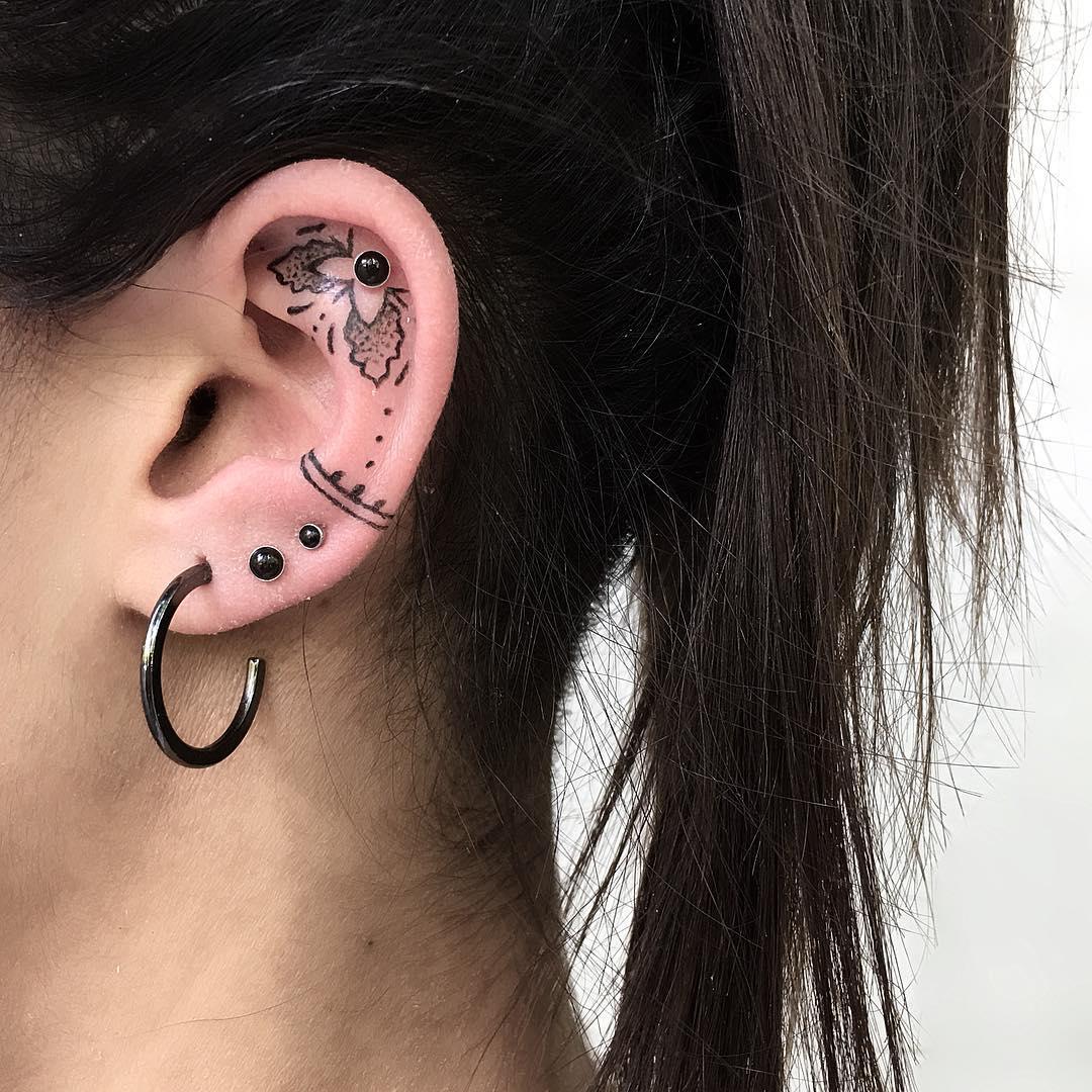Ear piece by @isaarttattoo