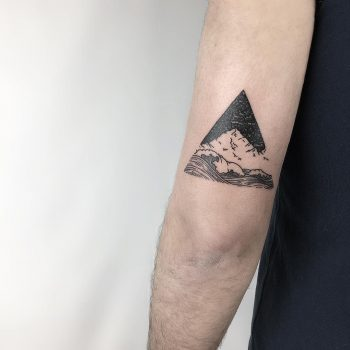 Mountain and waves by @isaarttattoo