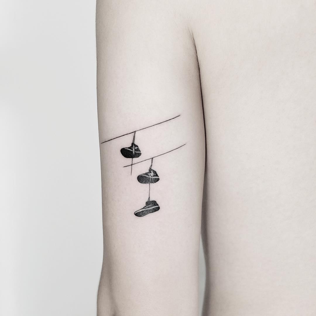 Shoes on a wire tattoo by @mateutsa