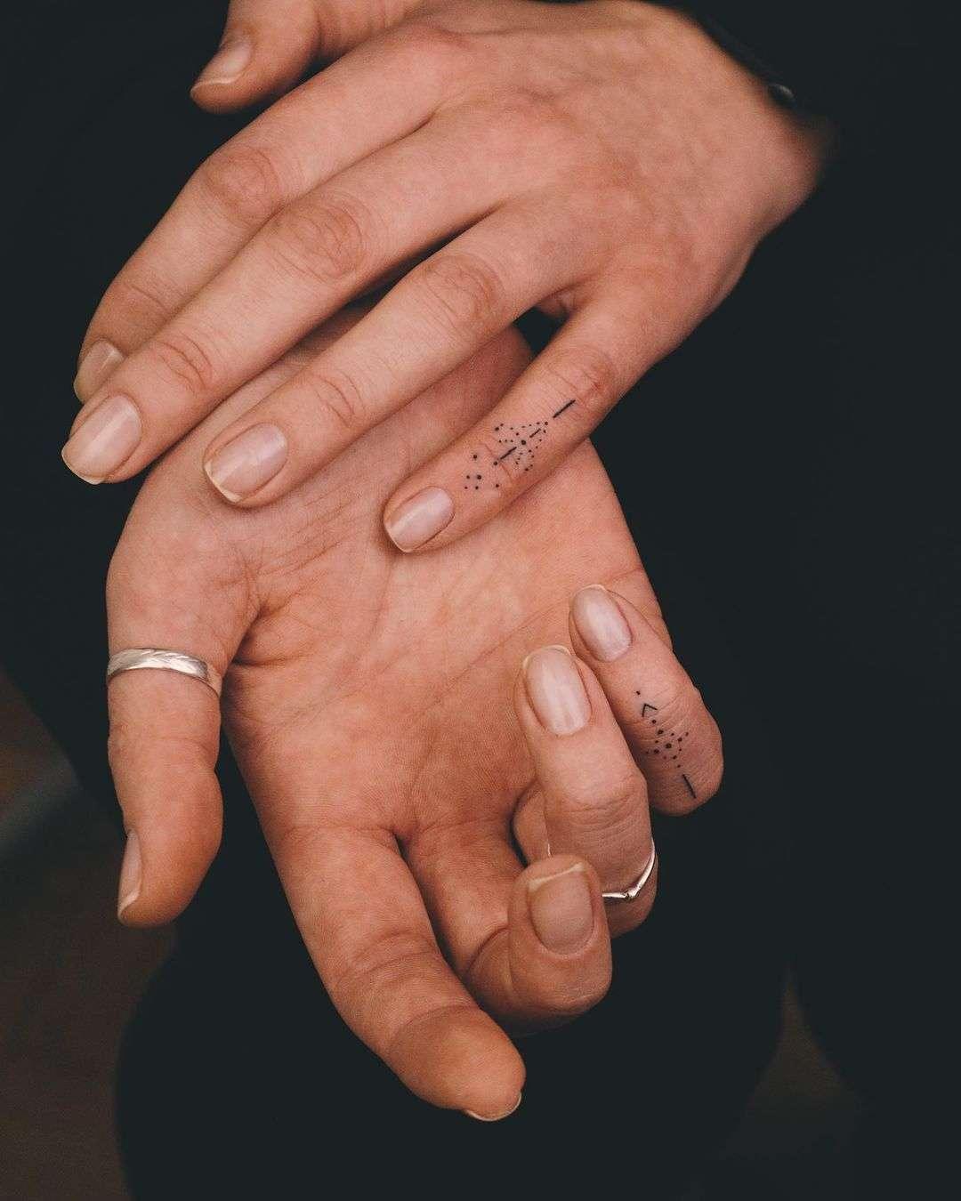 Subtle finger tattoos by @vlada.2wnt2