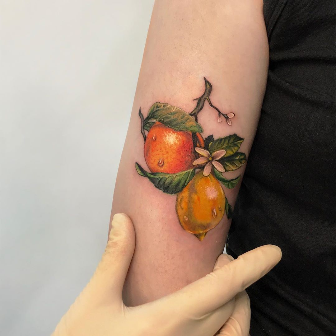 Citrus garden tattoo by tattooist Anna Zelenska