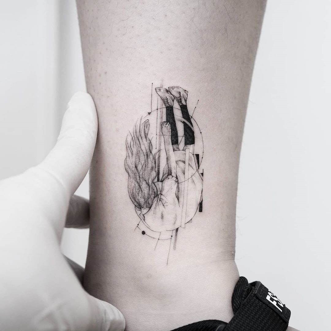Falling girl tattoo by tattooist Ian Wong