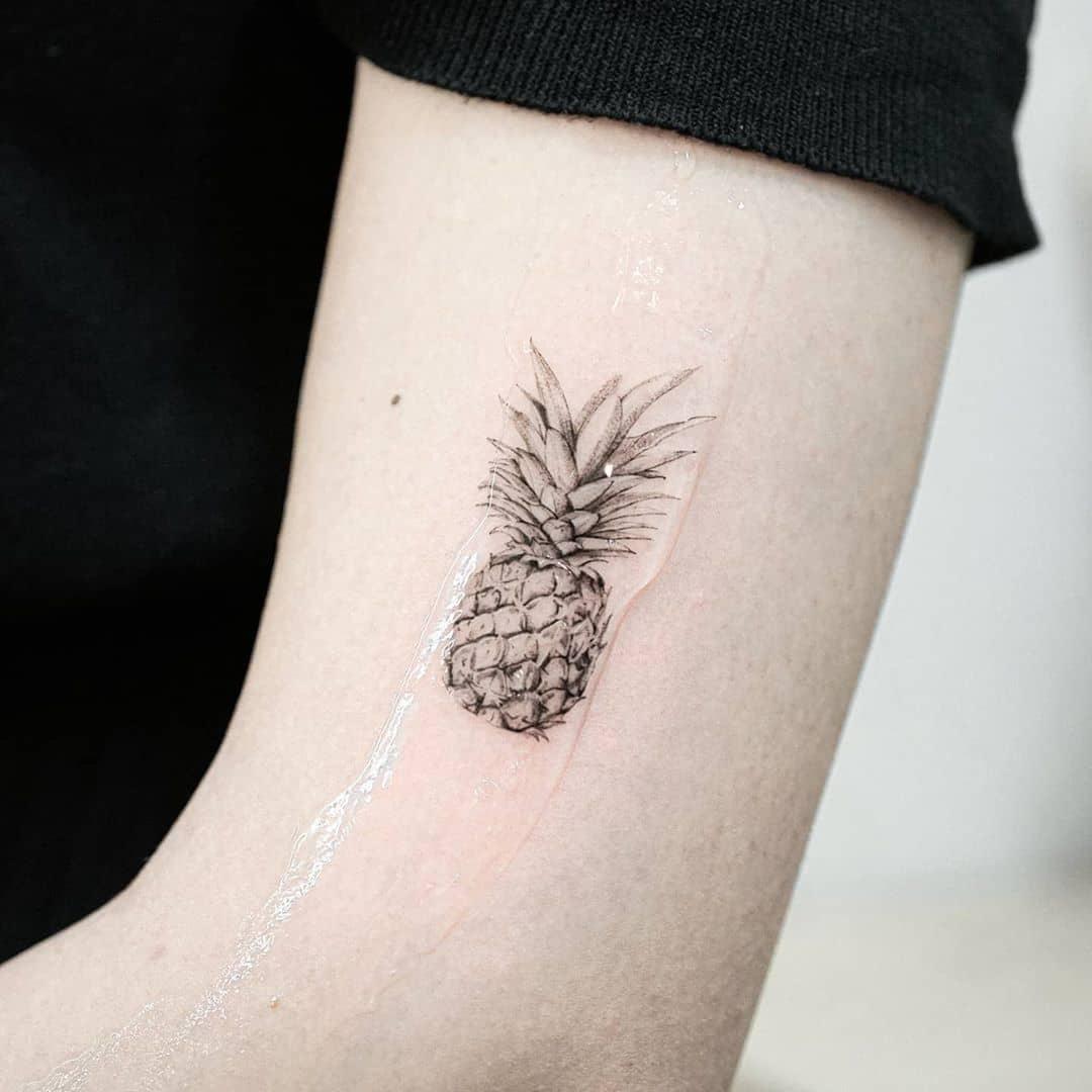 Mini pineapple by tattooist Ian Wong
