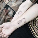 Matching LEGO tattoo by tattooist Ian Wong
