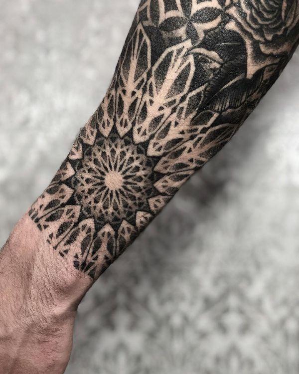 Blackwork Mandala on a Forearm by tattooist Arang Eleven