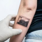Hong Kong Stamp Tattoo by tattooist Ian Wong